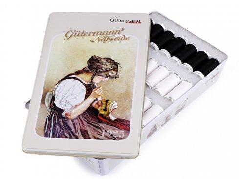 Sada bílých a černých nití PES Gütermann v plechové krabici